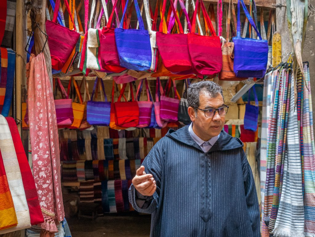Our tour guide showing the weavers in Fes